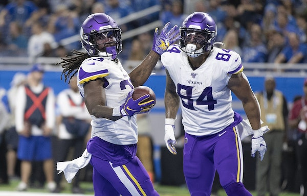 Minnesota Vikings running back Dalvin Cook (33) celebrated his fourth quarter touchdown run at Ford Field.with Irv Smith. Jr.