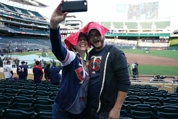 Stacey Green and Steve Frenzel take a selfie with Homer Hankies on their heads as fans prepared for Game 3.