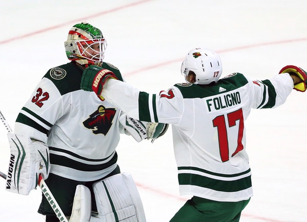 Wild goaltender Alex Stalock and Marcus Foligno celebrated after Stalock made 26 saves in defeating the Ottawa Senators 2-0 on Monday, earning the Wil
