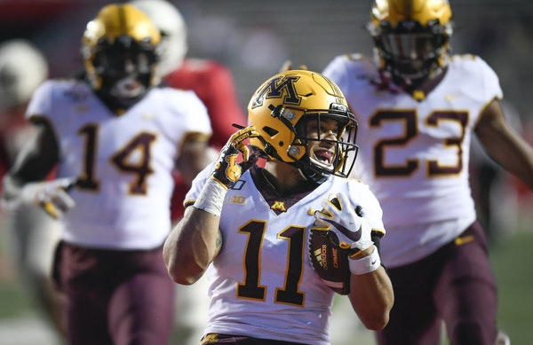 Gophers defensive back Antoine Winfield Jr. celebrated his fourth quarter touchdown on a pick-6 against Rutgers.
