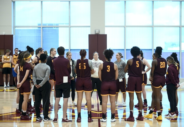 Gophers players huddled around head coach Lindsay Whalen, center, at the conclusion of their first practice Wednesday.