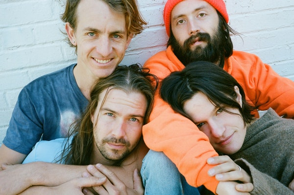 Adrianne Lenker, bottom right, with her Big Thief bandmates. From left: guitarist Buck Meek, bassist Max Oleartchik and drummer James Krivchenia.
