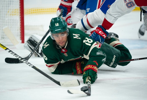 Wild left winger Jordan Greenway kept control of the puck after dropping to the ice in the first period against the Canadiens on Sunday.