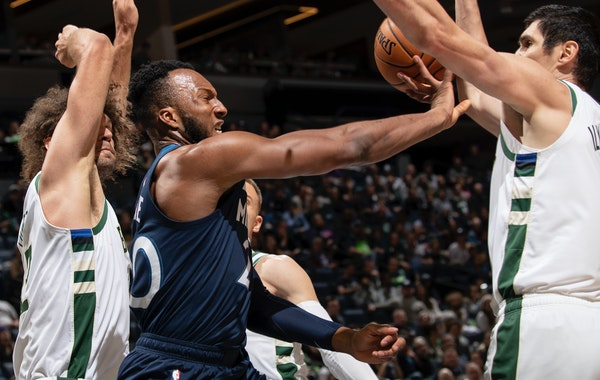 Wolves guard Josh Okogie tried to deliver a pass while trapped by two Bucks players in the third quarter Monday night. ] CARLOS GONZALEZ • cgonzalez