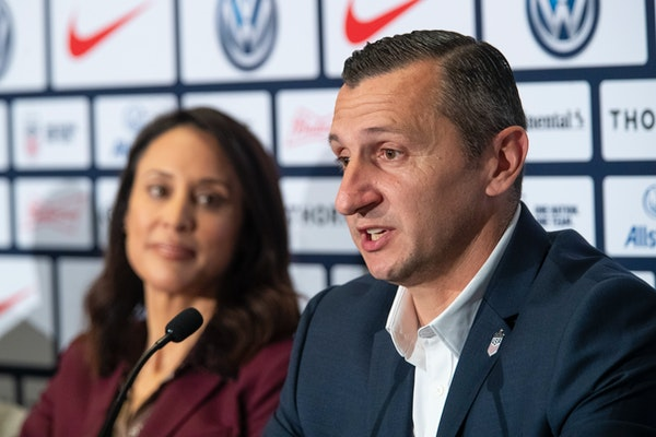 Kate Markgraf, general manager of the U.S. women's national soccer team, listens as newly hired head coach Vlatko Andonovski speaks at a news conferen
