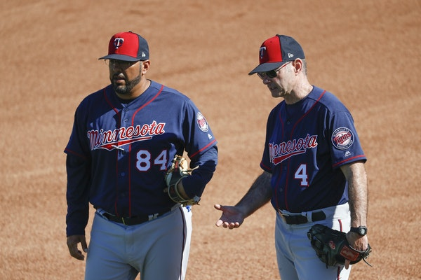 New Twins hitting coach Edgar Varela (left, with former manager Paul Molitor) spent 10 years with the Pirates before joining the Twins' minor league s