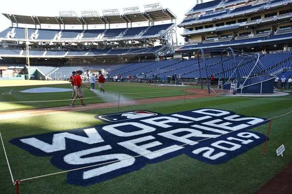 Groundskeepers prepare the infield for batting practice at Nationals Park in Washington, Thursday, Oct. 24, 2019. The Houston Astros and Washington Na