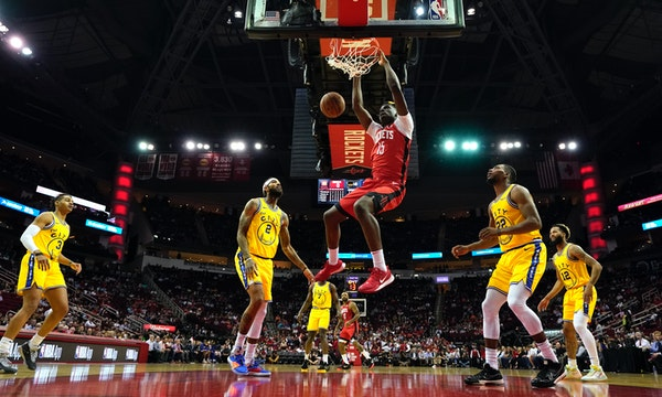 Houston's Clint Capela dunked on Wednesday night surrounded by a Warriors fivesome of Jordan Poole (3), Willie Cauley-Stein (2), Eric Paschall (7), Gl