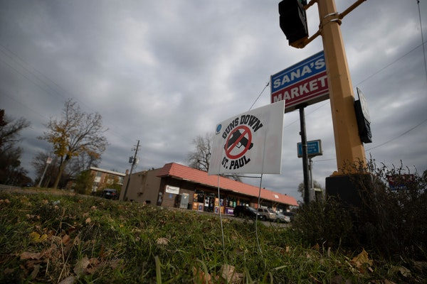 """A """"Guns Down St. Paul"""" sign was placed near the scene at E. Maryland Avenue and Hazelwood Street where a shooting happened over the weekend."""
