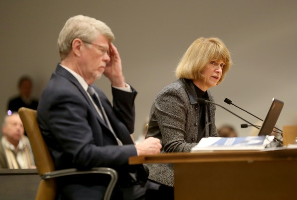 Legislative Auditor Jim Nobles, left, and Jodi Harpstead, Minnesota Department of Human Services commissioner in front of a Minnesota Senate committee