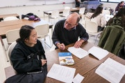 Teacher Christopher Weyandt, right, worked with student Grace Moua during English class at Century College in White Bear Lake on Wednesday, November 6