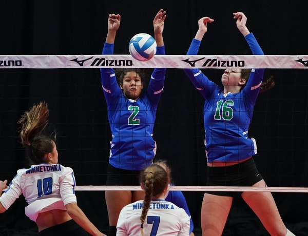 Kennedi Orr (2) and Kendal Kemp of Eagan went up for a block against a hit by Minnetonka's Skyler Germann (10).