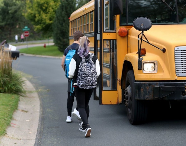 """Students in Eden Prairie walked to board a school bus nicknamed """"the secret bus,"""" to attend class in the Minnetonka district in 2017."""