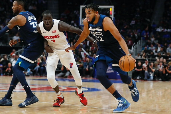 Timberwolves center Karl-Anthony Towns drove past Pistons forward Thon Maker during the second half Monday.