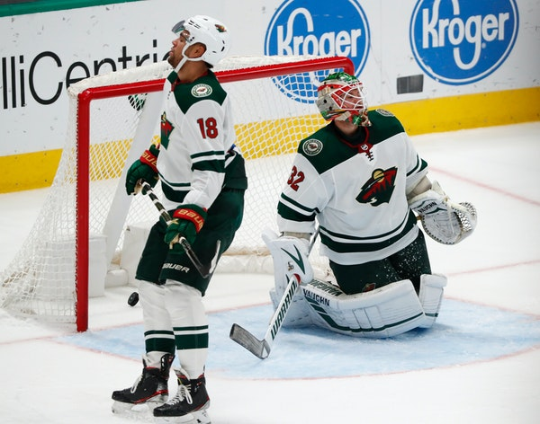 The Wild's Jordan Greenway and Alex Stalock look away after the Stars' Joe Pavelski scored in the third period