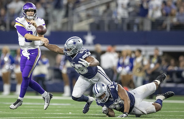 Above, Cowboys defenders Robert Quinn (58) and Michael Bennett had Kirk Cousins on the move in the third quarter. Below, Vikings linebackers Anthony B