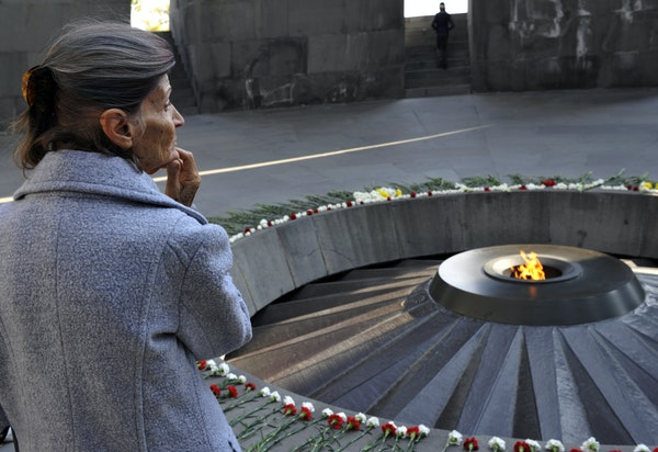 Visitors pay tribute to victims of the Armenian Genocide at the Tsitsernakaberd Memorial in Yerevan, Armenia, on Wednesday.