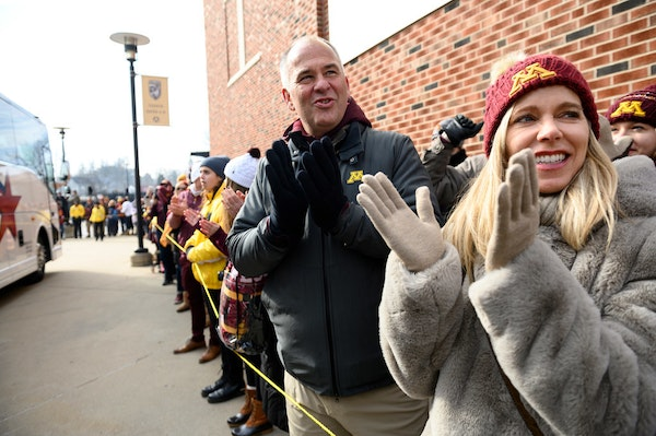 Michael and Bonnie Moe, now living in San Francisco, cheered for the Minnesota Gophers as they arrived outside Kinnick Stadium Saturday before their g