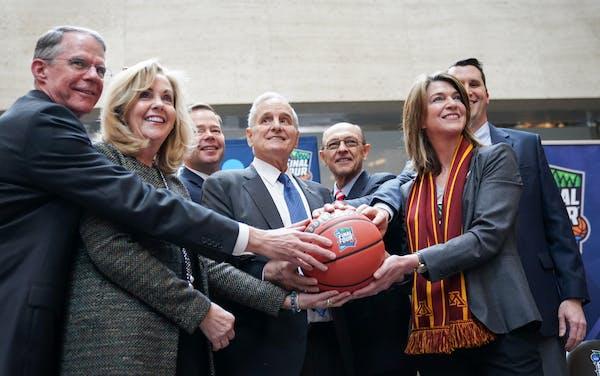 Richard Davis, Maureen Bausch, David Mortenson, Gov. Mark Dayton, Mike Vekich, Kate Mortenson, and Tom McGinnis got their hands on the ceremonial ball