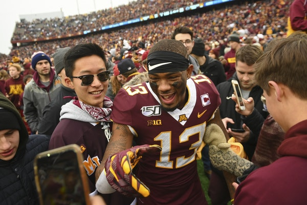 Gophers wide receiver Rashod Bateman (13), who caught seven passes for 203 yards and scored Minnesota's first touchdown, celebrated the victory with f
