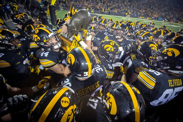 Iowa players hoisted the Floyd of Rosedale Trophy after the Hawkeyes defeated the Gophers 17-10 at Kinnick Stadium in 2017.