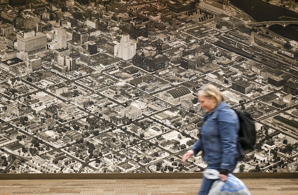 Large historical panoramas hang in the Wells Fargo Bank building's skyway in Downtown East.