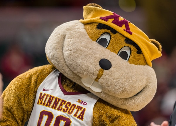 The Minnesota Golden Gophers mascot, Goldy, dances for the fans during a break in the first half of a quarter-final game in the 2018 NCAA Big Ten Wome