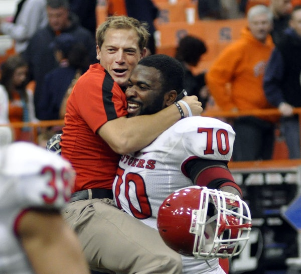 P.J. Fleck, then a wide receivers coach at Rutgers, and Desmond Wynn celebrate their 19-16 double overtime win over Syracuse on Oct. 1, 2011 at the Ca