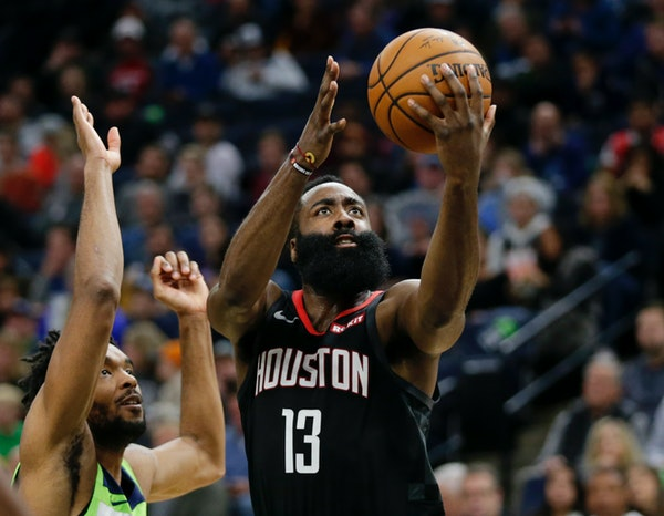 Rockets guard James Harden put up a shot against Timberwolves guard Keita Bates-Diop in the third quarter Saturday night.