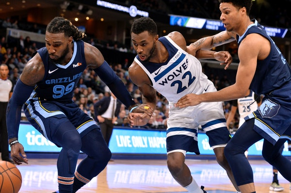 Memphis forward Jae Crowder (99), Timberwolves guard Andrew Wiggins (22), and Grizzlies forward Brandon Clarke chase a loose ball in the first half