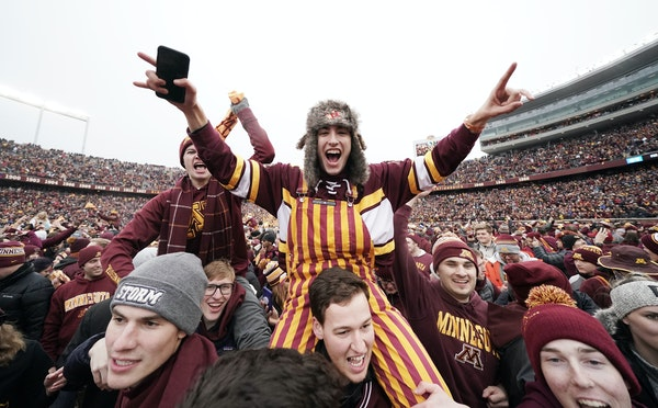 Gophers fans celebrated after their win over Penn State.