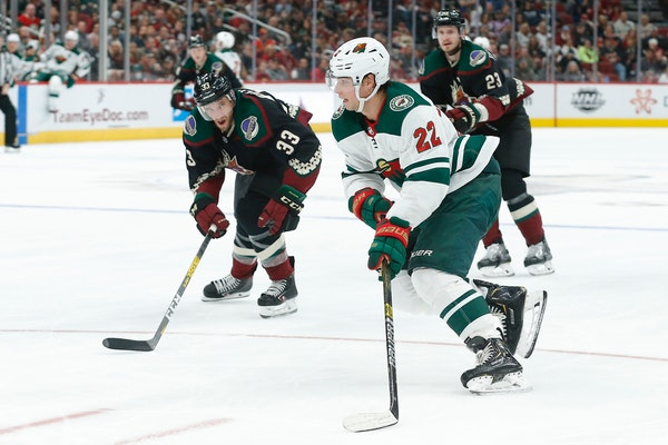 Minnesota Wild left wing Kevin Fiala carries the puck in front of Arizona Coyotes defenseman Alex Goligoski (33) in the third period during an NHL hoc