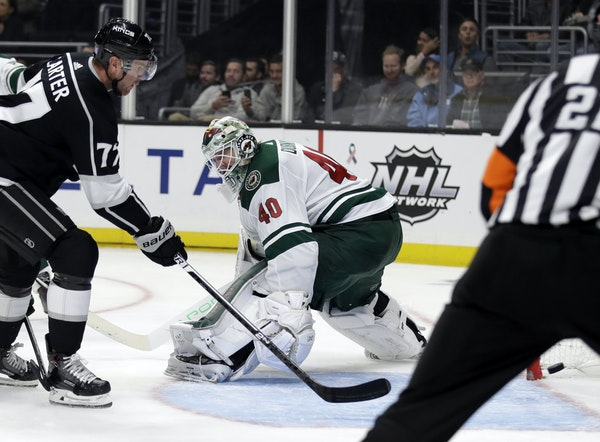 Los Angeles Kings' Jeff Carter (77) scores past Minnesota Wild goaltender Devan Dubnyk (40) during the second period of an NHL hockey game Tuesday,