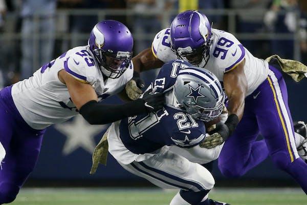 Anthony Barr and Danielle Hunter (99) of the Vikings stopped Cowboys running back Ezekiel Elliott on Sunday night.