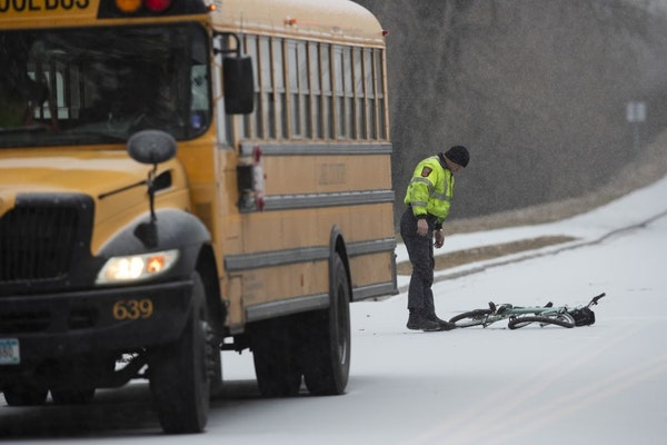 A Minnesota State Trooper investigated the scene where a bicyclist was killed after colliding with a school bus Wednesday morning on Zane Avenue and 6