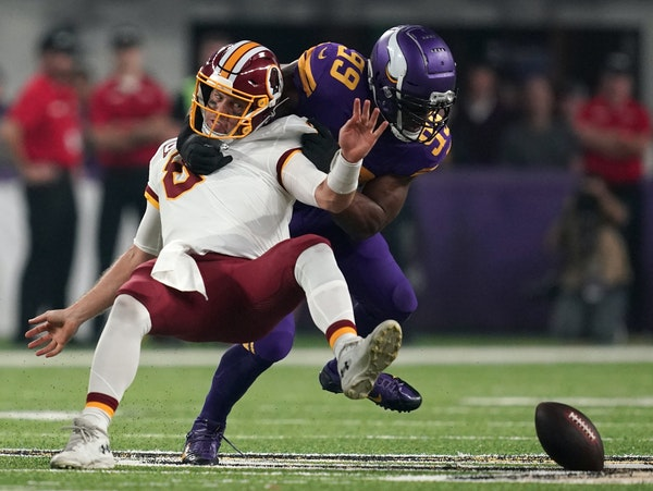 Vikings defensive end Danielle Hunter separated Redskins quarterback Case Keenum from the football during the first quarter at U.S. Bank Stadium on Th