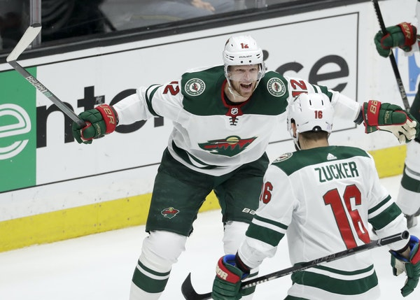 Wild center Eric Staal, left, celebrated with left wing Jason Zucker after scoring against the Ducks in the third period Tuesday.