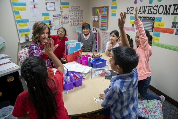 Prairie Elementary ELL third-grade teacher Molly Scheidt gave a high-five to a student in her small classroom that was formerly a storage closet at th