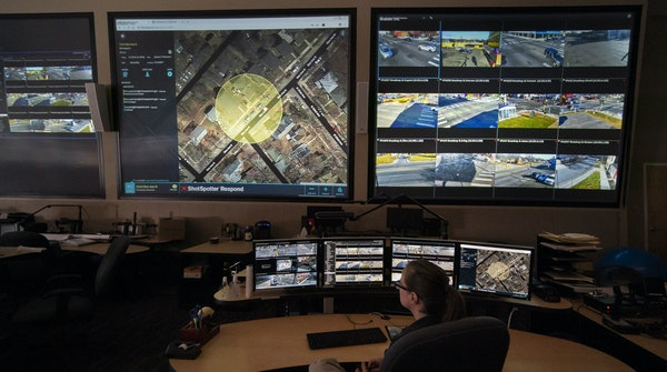 Officer Heidi Eisenbeis watched video evidence in Minneapolis. St. Paul's police chief wants ShotSpotter technology, but the mayor has doubts.