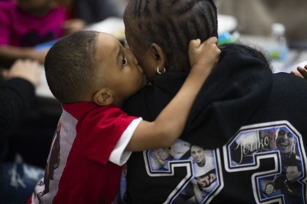 Jeriko Dejvaun Boykin Jr., 4, kissed his grandmother Catherine Harris at a listening session Tuesday about the violence in St. Paul. Jeriko Jr. was in