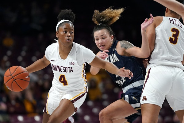 Gophers guard Jasmine Powell moved the ball around Bobcats guard Darian White (2) in the first half.