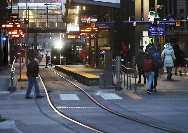 Commuters come and go at the Nicollet Mall station in downtown Minneapolis.