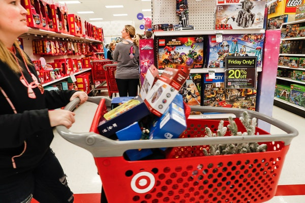 Shoppers browse the aisles during a Black Friday sale at a Target store, Friday, Nov. 23, 2018, in Newport, Ky.