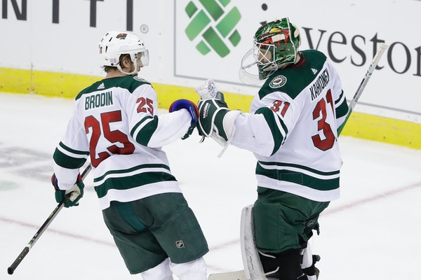 Wild defenseman Jonas Brodin celebrated with goaltender Kaapo Kahkonen after the goalie posted a 3-2 victory over the New Jersey Devils in his NHL deb