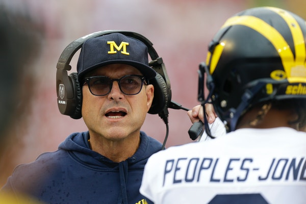 """Michigan coach Jim Harbaugh dubbed the coaches' and players' effort """"not acceptable"""" after being mauled at Wisconsin."""