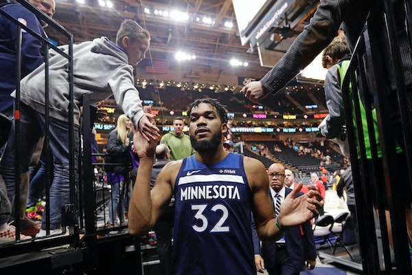 Fans slapped hands with Timberwolves center Karl-Anthony Towns (32) as he left the court Monday night. Towns had 29 points and 13 rebounds in the Wolv