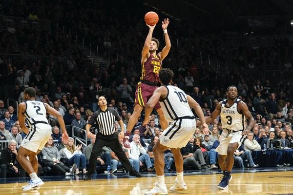 Gophers guard Gabe Kalscheur shoots in front of Butler forward Bryce Nze during a game earlier this month.