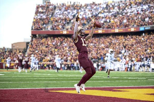 Gophers receiver Rashod Bateman celebrated his first quarter touchdown against Penn State.