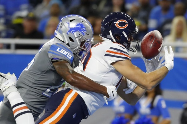 Chicago Bears tight end Jesper Horsted, defended by Detroit Lions defensive back Will Harris, catches an 18-yard pass for a touchdown