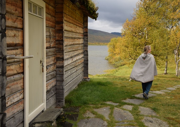 Anki Vinka runs the Sami Ecolodge alongside her husband, Mikael. While kerosene lamps are used at the secluded lodging, electricity and running water